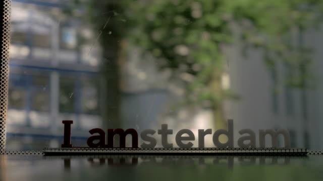 Ventana-de-mover-tranvía-i-lema-de-amsterdam