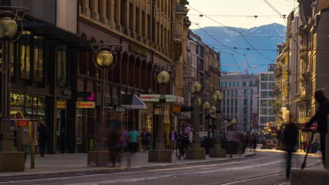 der-Schweiz-Sonnenuntergang-Licht-Genf-Stadtbild-Verkehr-Straße-Panorama-4k-Zeitraffer