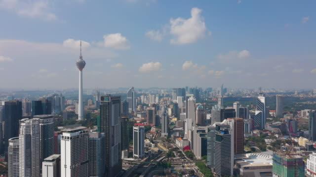 soleado-día-Kuala-Lumpur-ciudad-centro-famosa-Torre-Panorama-aéreo-4k-Malasia