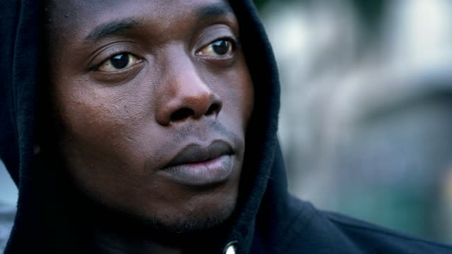 Thoughtful-sad-young-black-african-man-looking--outdoor
