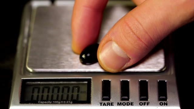 Close-up-of-electronic-scales-being-in-use-Laboratory-scales-Laboratory-worker-weighs-the-manufactured-tablets-on-the-control-scales-Pills-and-medication-health-close-up