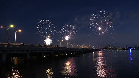 A-fireworks-display-over-water-marks-a-big-holiday-2