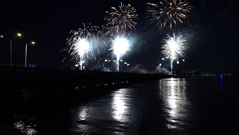 A-fireworks-display-over-water-marks-a-big-holiday-3