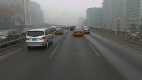 Taxis-and-vehicles-travel-along-busy-roads-in-China