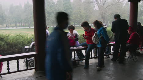 People-play-cards-in-a-gazebo-in-a-park-in-China