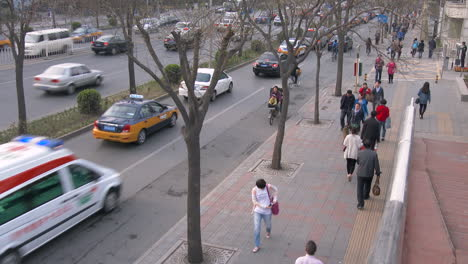 A-high-angle-over-a-Beijing-China-street-with-modern-traffic-and-pedestrians