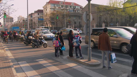 Traffic-passes-on-a-busy-Chinese-street