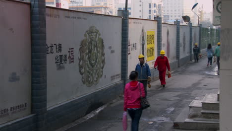 Chinese-factory-workers-walk-home-through-an-alleyway