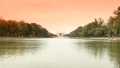A-long-shot-of-the-Lincoln-Memorial-across-the-reflecting-pool-with-ducks-swimming-past-1