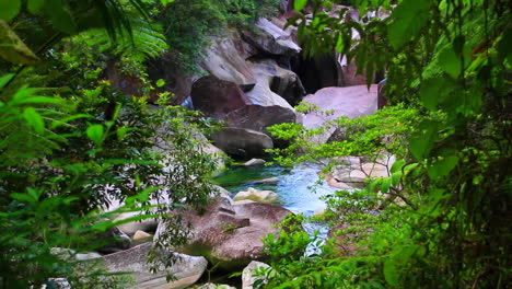 Generic-and-beautiful-small-river-or-stream-over-rocks-in-a-forest-in-Queensland-Australia