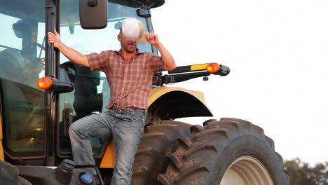 A-handsome-farmer-stands-aside-his-tractor-1