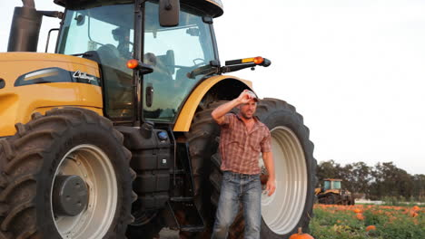 A-handsome-farmer-stands-aside-his-tractor-2