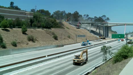 Pan-left-to-right-over-an-empty-stretch-of-the-405-freeway-in-Los-Angles-as-crews-tear-down-part-of-a-bridge