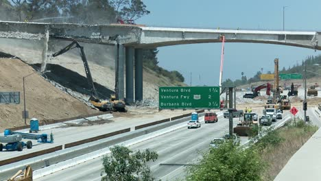 View-of-heavy-equipment-tearing-down-part-of-a-bridge-over-the-405-freeway-in-Los-Angles