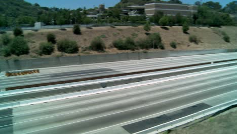 Zoom-out-and-pan-right-to-left-over-an-empty-stretch-of-the-405-freeway-in-Los-Angles-as-crews-tear-down-part-of-a-bridge