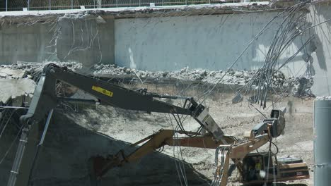 Heavy-equipment-crushes-a-portion-of-a-bridge-stretching-over-the-405-freeway-in-Los-Angeles-1