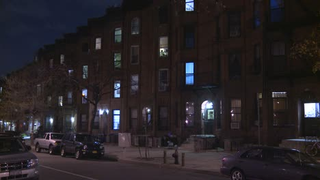Street-level-shot-of-building-exteriors-in-Brooklyn-at-night-1