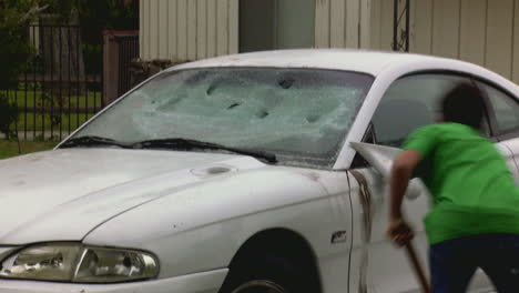 A-man-destroys-his-car-with-a-sledgehammer-3