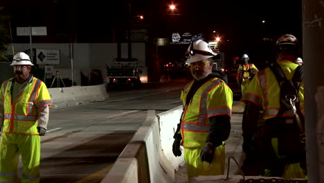 American-workers-build-road-infrastructure-at-night