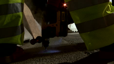 American-workers-build-road-infrastructure-at-night-1