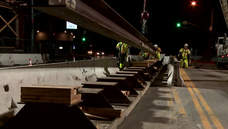 Construction-workers-work-on-a-freeway-overpass-in-time-lapse-at-night-in-Los-Angeles-1