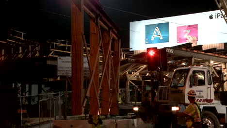 Construction-workers-work-on-a-freeway-overpass-at-night-in-Los-Angeles-1