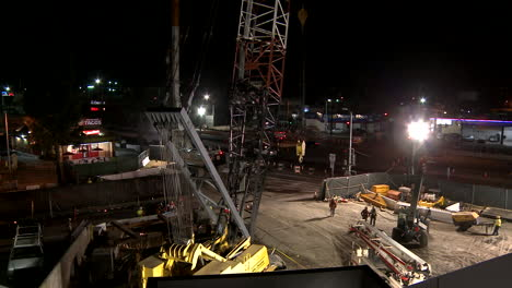Construction-workers-work-on-a-freeway-overpass-in-time-lapse-at-night-in-Los-Angeles-4