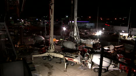 A-crane-works-on-a-freeway-overpass-at-night-in-Los-Angeles-in-time-lapse