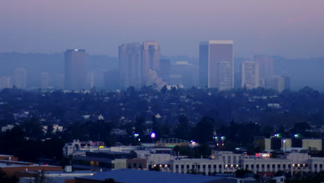 A-time-lapse-night-to-day-zoom-back-shot-of-Los-Angeles-downtown-skyline-California