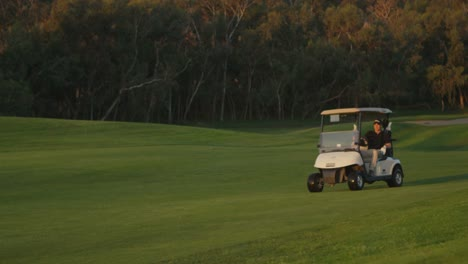 Golfers-ride-in-a-cart-on-a-golf-course