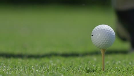 Closeup-of-a-golf-ball-being-hit-off-a-tee