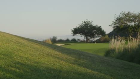 Wide-shot-from-a-hill-over-looking-a-golf-course