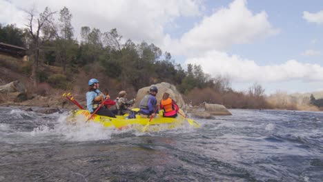 A-group-paddles-in-an-inflatable-raft-on-a-fast-flowing-river