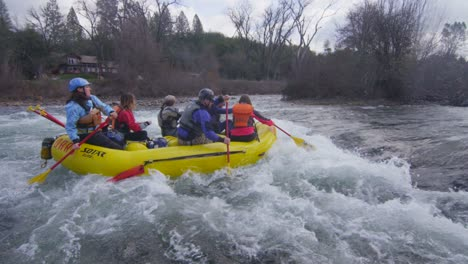 Rafters-paddle-through-rapids-on-a-river