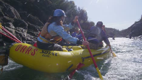 Rafters-paddle-and-negotiate-rapids-on-a-fast-flowing-river