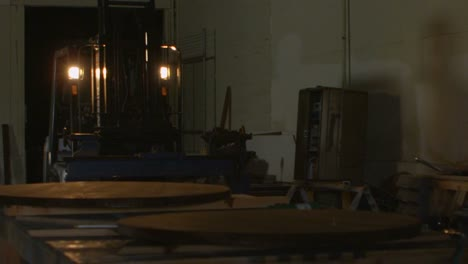 A-forklift-maneuvers-in-a-woodworking-shop