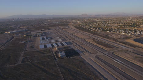 Aerial-view-of-a-small-airport-near-Las-Vegas-Nevada-with-suburban-sprawl-in-the-distance