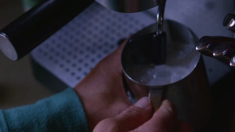 Closeup-of-milk-frothing-at-an-espresso-machine