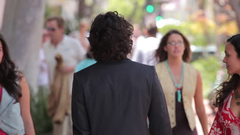 Women-stop-and-look-at-a-well-dressed-man-walking-down-the-street