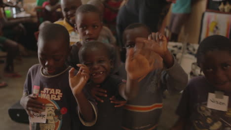African-children-wave-at-the-camera
