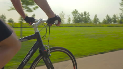 Traveling-shot-of-a-mountain-biker-riding-on-a-park-trail-near-Chicago-3