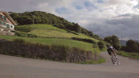 A-mountain-biker-moves-fast-on-a-two-lane-highway-in-Europe
