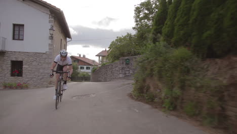 A-mountain-biker-moves-fast-on-a-two-lane-highway-in-Europe-1