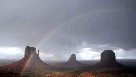 A-rainbow-forms-in-the-sunlight-following-a-storm-over-Monument-Valley-Utah