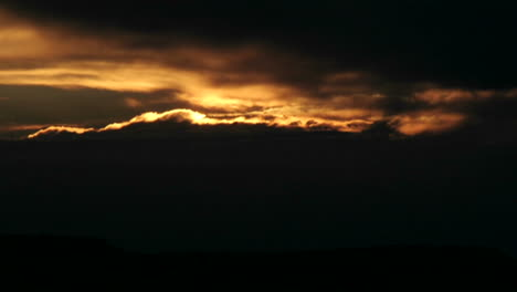 The-bright-sun-disappears-behind-clouds-in-a-darkening-sky