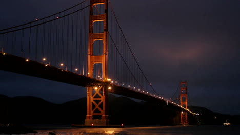 San-Francisco-s-Golden-Gate-Bridge-is-illuminated-in-a-darkening-sky
