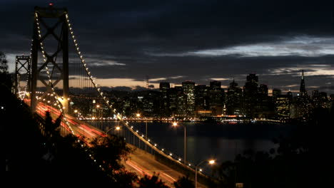 San-Francisco-s-Oakland-Bay-Bridge-grows-brighter-as-darkness-falls-over-the-city-skyline