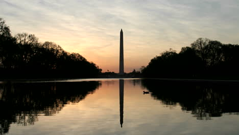 The-Washington-Monument-is-silhouetted-against-a-colorful-sky-in-Washington-DC