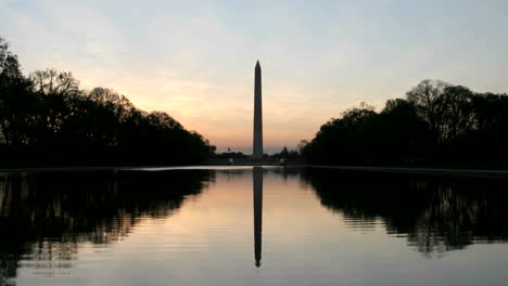 The-Washington-Monument-is-silhouetted-against-a-colorful-sky-in-Washington-DC-1