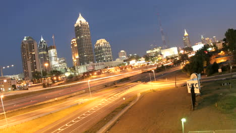 Lights-brighten-in-downtown-Atlanta-Georgia-and-its-surrounding-highways-as-evening-changes-to-night
